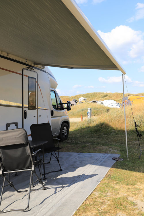 RV with awning at campsite